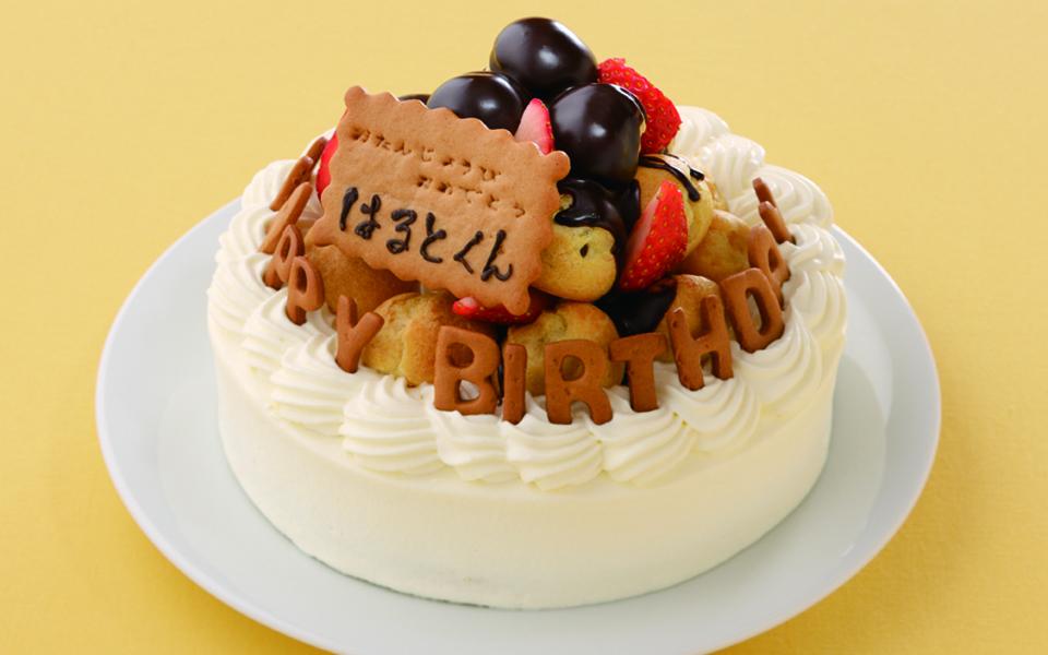 山盛りシューの誕生日ケーキの画像